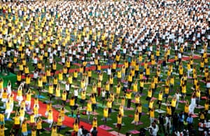 Bangalore, India Enthusiasts attend a mass yoga demonstration