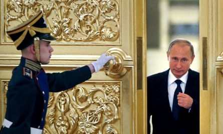 A guard opens the door for Vladimir Putin as he attends a meeting of the presidential council for civil society and human rights in Moscow