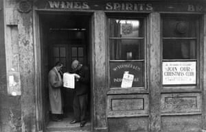 Bookmaker outside Aird's Bar, Arthur Street, 1960Born in Leeds in 1938, Robert Blomfield was practising street photography in the UK from the late 1950s through to the early 1970s. His photographs went unseen outside of close friends and family for most of his life. Once they were dry, his prints would usually go straight back into their yellow Kodak boxes and would often not see the light of day again for many years