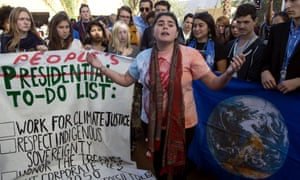 American students protest outside the UN climate talks in reaction to Trump's victory.