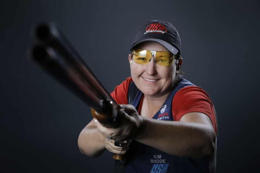 "Kim RhodeFILE - In this March 8, 2016, file photo, double trap and skeet shooter Kim Rhode poses for photos at the 2016 Team USA Media Summit in Beverly Hills, Calif. Mass shootings exacerbate the rift over gun control and often put Olympic shooters in the crosshairs of hate. ""It's unfortunate that we get lumped in with that,"" said Rhode, who is vying to become the first American athlete to win medals in a sixth straight Games at next month's Rio Olympics. ""There has to be some kind of reality."" (AP Photo/Jae C. Hong, File)"