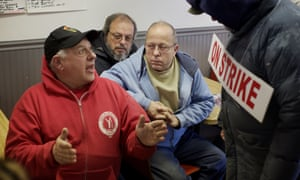 Momentive pipe fitter Robert Hohn (center) listens to Dominick Patrignani (left), local president of IUE-CWA 81359 at strike headquarters in an old hotdog restaurant.