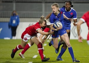 France's Morgane Peyronnet is tackled by Elinor Snowsill of Wales.