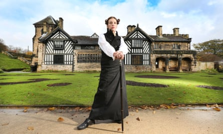 A model dressed as Anne Lister stands in front of Shibden Hall, Halifax