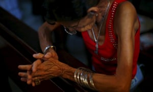 A woman prays during a mass celebrating Pope Francis's visit in Havana.