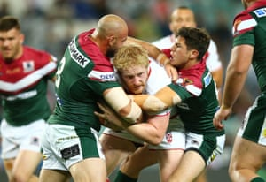 James Graham of England is tackled.
