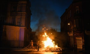 Firefighters at the bonfire in the east Belfast