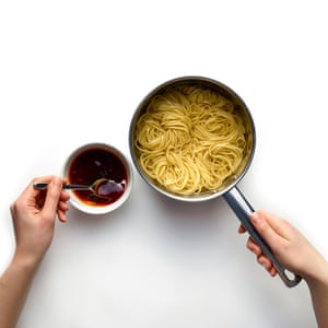 Once the noodles are cooked, add some of their starchy cooking water to the sauce, along with some chilli oil.