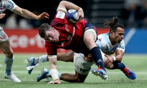 Munster's Peter O'Mahony is brought to ground by Teddy Thomas in Paris.