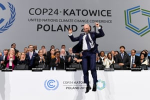 Katowice, Poland: Michał Kurtyka, president of the COP24 climate talks, celebrates at the end of the final session