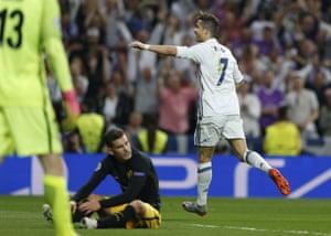 Cristiano Ronaldo celebrates scoring his hat-trick.