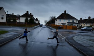 Children playing on Pennard Avenue in Knowsley, Merseyside.