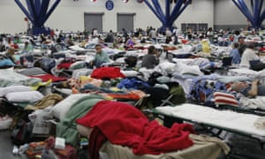 People rest at the George Brown Convention Centre which has been opened as a shelter in Houston, Texas, after Hurricane Harvey.