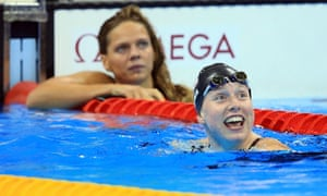 Lilly King (right) celebrates victory as her rival Yulia Efimova looks on