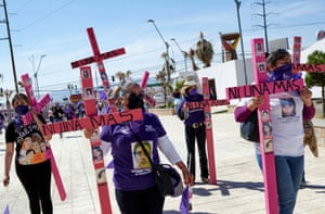 Mothers and relatives walk holding crosses during an event demanding an end to violence against women and femicide in Ciudad Juárez, Mexico