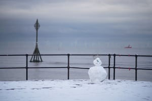 A snowman on the promenade at Crosby in Liverpool