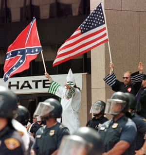 Darker uses … Ku Klux Klan leaders wave flags at a rally in Cleveland, Ohio.