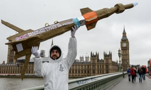 Activists march across Westminster Bridge with homemade replica missiles in protest over British arms sales to Saudi Arabia
