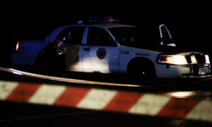 A police photographer takes pictures of a Des Moines police vehicle after two police officers were shot and killed.