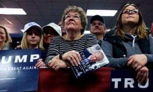 Supporters look on as Republican presidential candidate Donald Trump speaks in Norwalk, Iowa