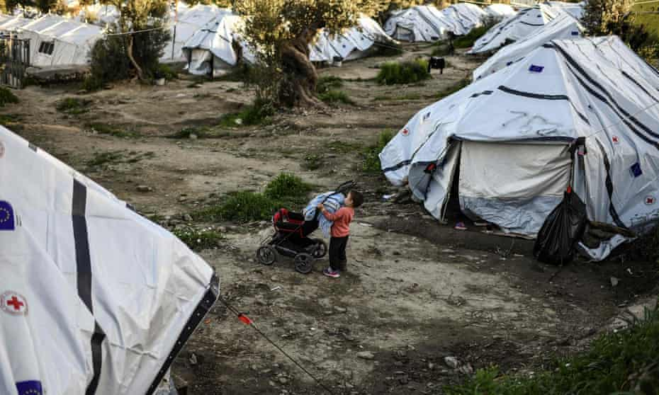 A boy at an unofficial camp on the Greek island of Lesbos.