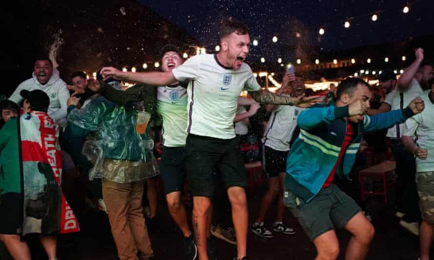 Fans celebrate the winning goal at Luna Springs in Birmingham.