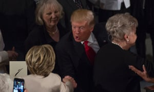 US President Donald Trump greets Hillary Clinton