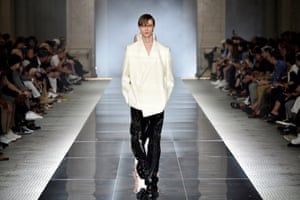 """Dunhill   Creative director, Mark Weston, said he wanted """"elegance and austerity disrupted by sensuality and provocation"""" for this collection. It presented in razor-sharp tailoring that was wrapped, belted and folded asymmetrically, butter-smooth summer wools and the cleanest of leather that was cinched and ruched. Pristine whites and jet blacks dominated, punctuated only by hints of jewel-toned amethyst and amber. It was Weston's way to pay homage to Japanese design, he said, and how it intersected with British culture."""