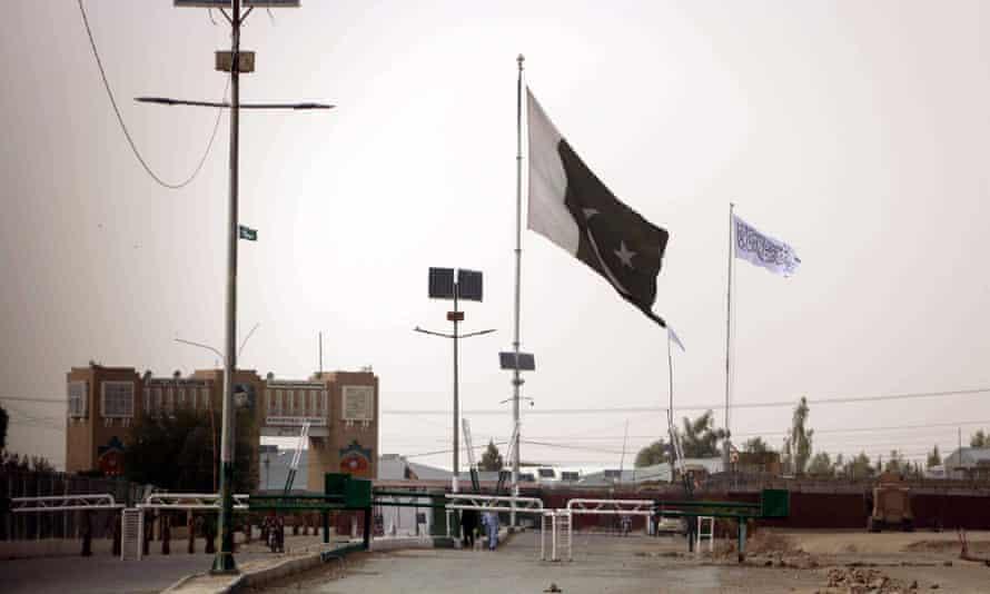 A Taliban flag is raised on the Afghan side of the Pakistani-Afghan border.