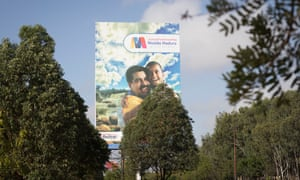 Political propaganda with Nicolás Maduro hugging a child, seen in the streets of Puerto Ordaz, Venezuela.