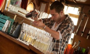 A barman mixes cocktails on The Liquorists' bourbon-based barge cruise in Manchester.