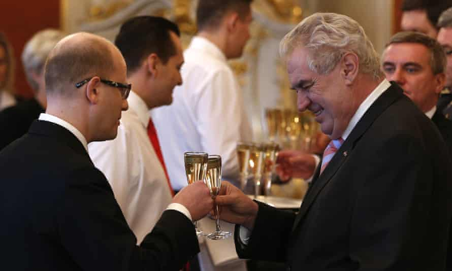 Newly appointed prime minister Bohuslav Sobotka, left, is toasted by president Milos Zeman in the photo from 2014.