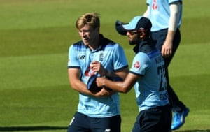 David Willey of England is congratulated by Saqib Mahmood after taking five wickets.