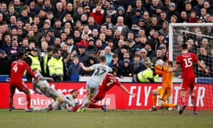 Martyn Waghorn bundles the ball over the line.