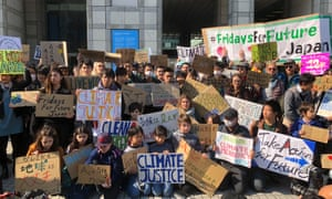 Students gathered outside United Nations University in Tokyo as part of the global climate strike.