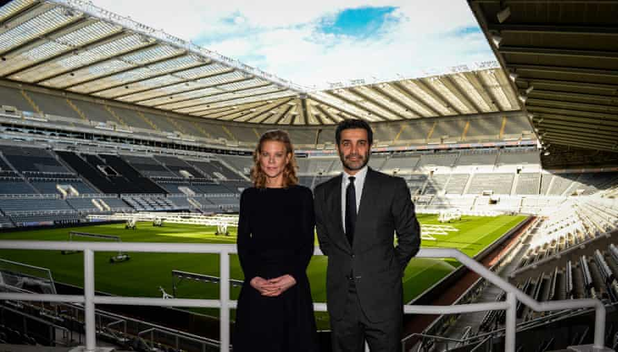 Amanda Staveley and Mehrdad Ghodoussi pose for photographs inside St James' Park after meeting with staff on Friday.