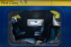 The smashed window of train carriage after protests in Hong Kong, China