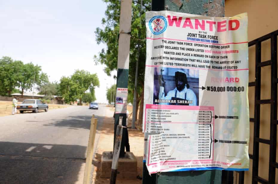 A wanted poster for Boko Haram leader Abubakar Shekau in Maduguri in 2013.