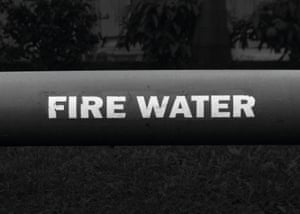 Mumbai Industrial pipe Painted on an enormous pipe running through an industrial plant these completely opposing words are actually a safety message. Influenced fundamentally by Marcel Duchamp's 'Water & Gas on every floor' taken out of context they create a beautiful surrealist moment.