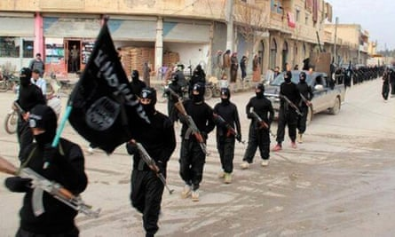 Islamic State fighters marching in Raqqa, Syria.