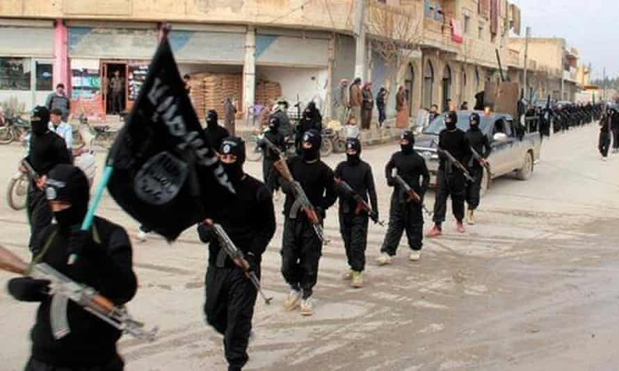 Isis fighters marching in Raqqa in 2014