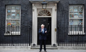Boris Johnson applauds outside 10 Downing Street during the Clap for our Carers campaign in London