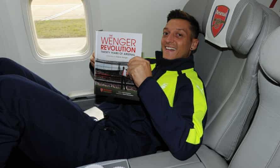 Arsenal player Mesut Ozil on the Arsenal plane to Paris from Luton Airport.
