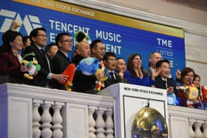 Cussion Kar Shun Pang, CEO of Tencent Music Entertainment and members of the company's leadership team ring the opening bell to celebrate company's IPO on the floor of the New York Stock Exchange (NYSE) in New York, U.S., December 12, 2018. REUTERS/Bryan R Smith