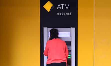 A customer uses an ATM at a Commonwealth Bank in Sydney