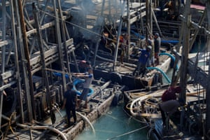 Often grouped together around undersea tin seams, the ramshackle encampments of pontoons emit plumes of black smoke from diesel generators that rumble so loudly workers use hand gestures to communicate
