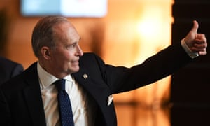 White House economic adviser Larry Kudlow gestures as he walks through a hotel lobby in Beijing today