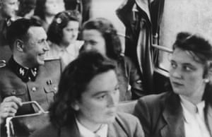 The SS auxiliaries travelled to the rest hut by bus. In this photograph, Höcker is seen laughing while a young woman in front sits half-turned as though to listen to what he might be saying. By this stage of the war, school leavers were being conscripted as SS auxiliaries – perhaps this woman was one of them. It is tempting to wonder, if she survived the war and had a family, what she told her children about how she spent the last months of the war