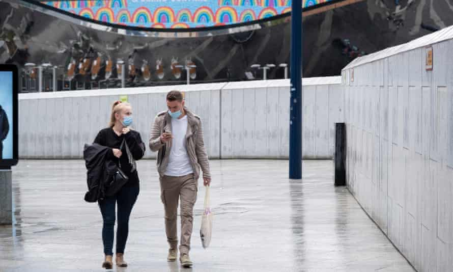 People wearing face masks in Birmingham city centre.
