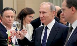 Vladimir Putin has called Donald Trump a 'smart man' over his business record.